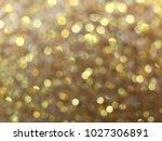 gold glitter light background | Shutterstock . vector #1027306891