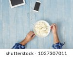 healthy breakfast. man eats... | Shutterstock . vector #1027307011