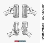 hands holding beer glasses set. ... | Shutterstock .eps vector #1027309384