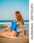 attractive caucasian woman in... | Shutterstock . vector #1027311241