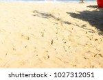 the sand on the pattaya beach... | Shutterstock . vector #1027312051