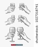 hands holding glasses set.... | Shutterstock .eps vector #1027318741