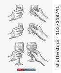 hands holding glasses set.... | Shutterstock .eps vector #1027318741