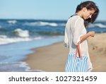 woman enjoying a walk on the... | Shutterstock . vector #1027321459