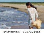 woman enjoying a walk on the... | Shutterstock . vector #1027321465