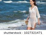 woman enjoying a walk on the... | Shutterstock . vector #1027321471