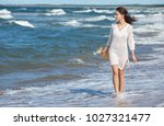 woman enjoying a walk on the...   Shutterstock . vector #1027321477