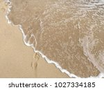 sea wave with bubbles hits the... | Shutterstock . vector #1027334185