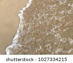 sea wave with bubbles hits the... | Shutterstock . vector #1027334215