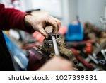 close up shot of worker hands... | Shutterstock . vector #1027339831