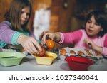 two girls enjoying in easter... | Shutterstock . vector #1027340041