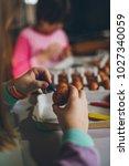 two girls enjoying in easter... | Shutterstock . vector #1027340059