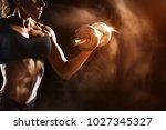 muscular fitness woman doing... | Shutterstock . vector #1027345327