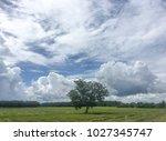 a cloud at dusk awaits the... | Shutterstock . vector #1027345747