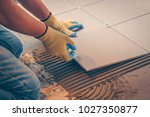 the tile glues the tile to the... | Shutterstock . vector #1027350877