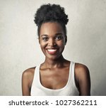 portrait of smiling woman  | Shutterstock . vector #1027362211