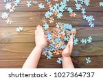 puzzles  hands on the... | Shutterstock . vector #1027364737