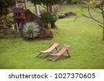 beach loungers in the mountains ... | Shutterstock . vector #1027370605