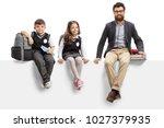 schoolboy  schoolgirl and a... | Shutterstock . vector #1027379935
