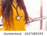 doctor beautiful girl in yellow ... | Shutterstock . vector #1027389295