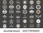 vintage retro vector logo for... | Shutterstock .eps vector #1027394005