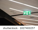 Green Emergency Exit Sign In...