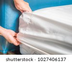 woman is putting the bedding... | Shutterstock . vector #1027406137