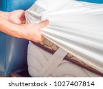 woman is putting the bedding... | Shutterstock . vector #1027407814