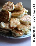thick russian pancakes piled on ... | Shutterstock . vector #1027413955