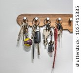 Small photo of Key holder with keys hanging on the wall