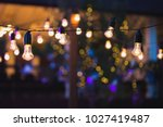 outdoor string lights hanging... | Shutterstock . vector #1027419487