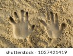 two handed shape in the sand... | Shutterstock . vector #1027421419