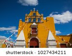 yellow colonial church in... | Shutterstock . vector #1027434211