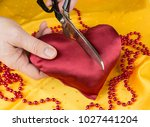 satin heart cut with scissors.... | Shutterstock . vector #1027441204