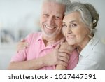 happy senior couple at home | Shutterstock . vector #1027447591