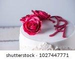 beautiful white wedding cake... | Shutterstock . vector #1027447771