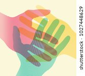 overlapping colorful hands... | Shutterstock .eps vector #1027448629