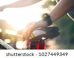 woman cyclist hand with smart... | Shutterstock . vector #1027449349