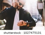 handsome man having mobile... | Shutterstock . vector #1027475131