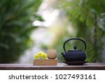 old black tea pot with brown... | Shutterstock . vector #1027493161