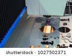 the fiber laser cutting the... | Shutterstock . vector #1027502371