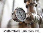 pressure gauge of white metal   ... | Shutterstock . vector #1027507441