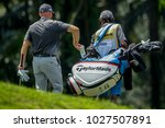 Small photo of SUBANG, MALAYSIA - FEBRUARY 01, 2018. Jarin Todd from United States with his caddie during the 2018 Maybank Championship golf tournament at the Saujana Golf and Country Club in Subang, Selangor.
