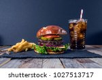 cheeseburger with fries | Shutterstock . vector #1027513717
