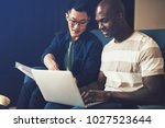 two diverse work colleagues...   Shutterstock . vector #1027523644