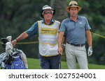 Small photo of SUBANG, MALAYSIA - FEBRUARY 01, 2018. Robert Rock from England with his caddie during the 2018 Maybank Championship golf tournament at the Saujana Golf and Country Club in Subang, Selangor.