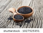 black cumin on wooden background | Shutterstock . vector #1027525351