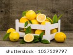 fresh lemons in the crate | Shutterstock . vector #1027529797