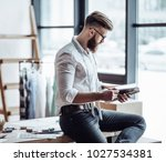 handsome male fashion designer... | Shutterstock . vector #1027534381