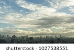 blue sky over the city after... | Shutterstock . vector #1027538551